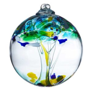 """During Best of Stowe 2021, you can purchase a specially priced """"Stronger Together"""" commemorative hand blown glass ball, like the one pictured with swirls of blues, greens and yellows"""